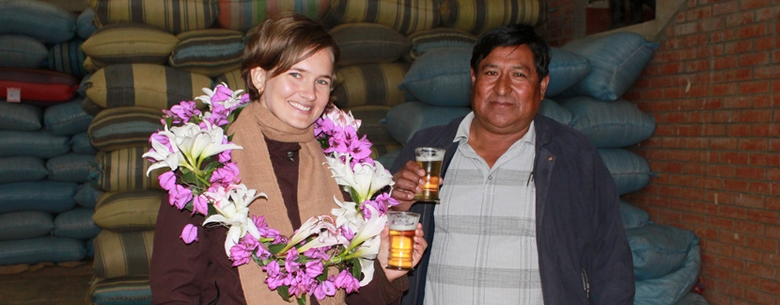 Coffee buyer and Sustainability Manager Kim Elena is welcomed by a coffee community in Bolivia.